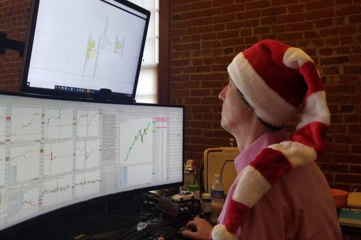 image of Peter Reznicek trading in Santa hat